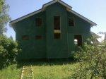 Дом обшит ветрозащитной плитой «Изоплат» 24 мм