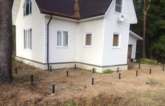 Винтовые сваи под террасу к каркасному дому